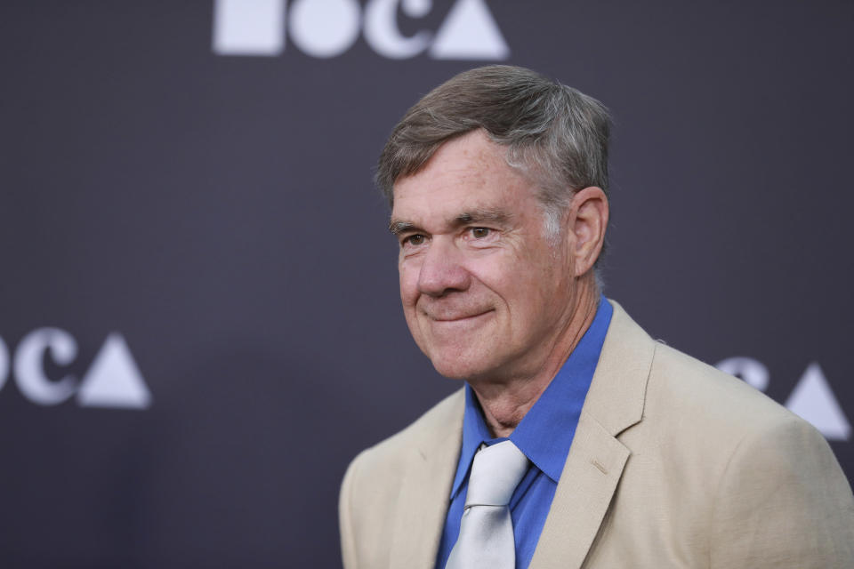 """FILE - In this May 18, 2019 file photo, director Gus Van Sant attends the 2019 MOCA benefit at the Geffen Contemporary, in Los Angeles. Gucci creative director Alessandro Michele teamed up with film director Gus Van Sant to create a seven-part mini-series revealing Gucci's latest collection, dubbed """"Ouverture."""" (Photo by Mark Von Holden/Invision/AP)"""