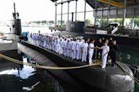 The crew and officers of the KRI Nanggala 402 appear in a ceremony at the naval base in Surabaya in this February 2019 photo