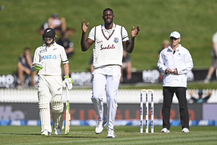The West Indies bowler Jason Holder, centre, reacts during play on day one of the first cricket test against New Zealand in Hamilton, New Zealand, Thursday, Dec. 3, 2020. (Andrew Cornaga/Photosport via AP)
