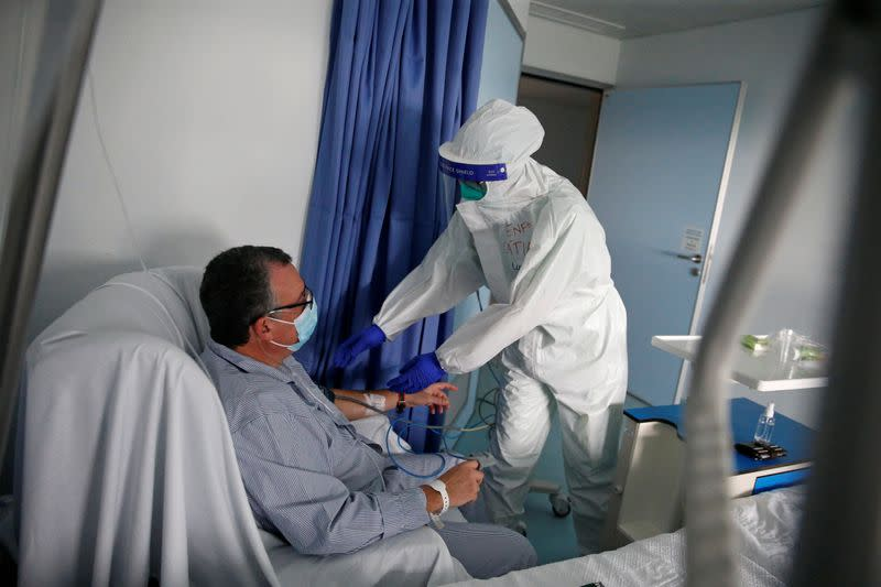 A nurse checks a patient in the COVID-19 ward of Cascais Hospital amid the coronavirus disease (COVID-19) pandemic in Cascais