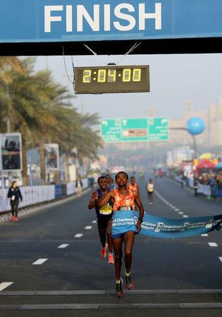 Geremew Bayih of Ethiopia crosses the finish line at the Dubai Marathon in Dubai, UAE January 26, 2018. REUTERS/Satish Kumar