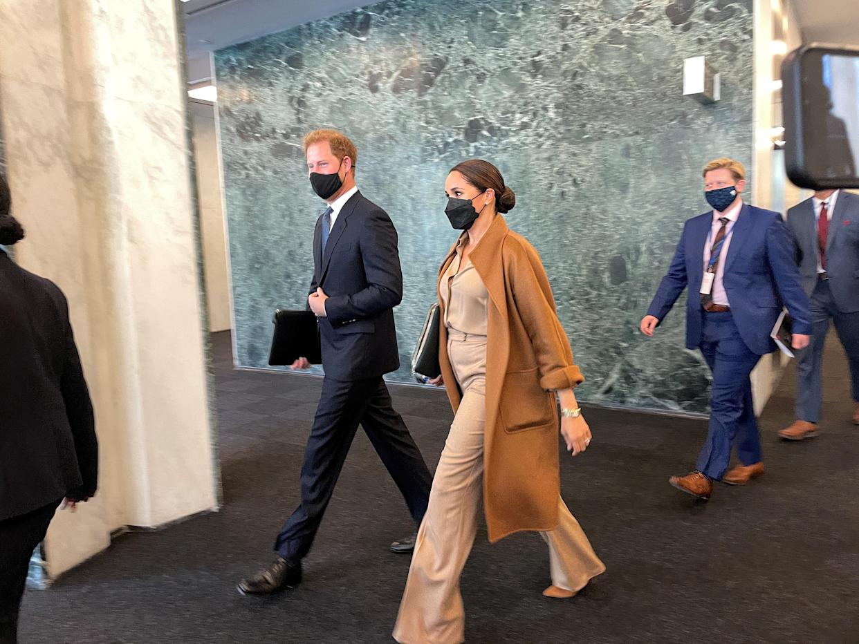 Prince Harry and Meghan Markle leave the United Nations after meeting with U.N. Deputy Secretary-General Amina Mohammed, in New York City, U.S., September 25, 2021. REUTERS/Daphne Psaledakis REFILE - CORRECTING ID