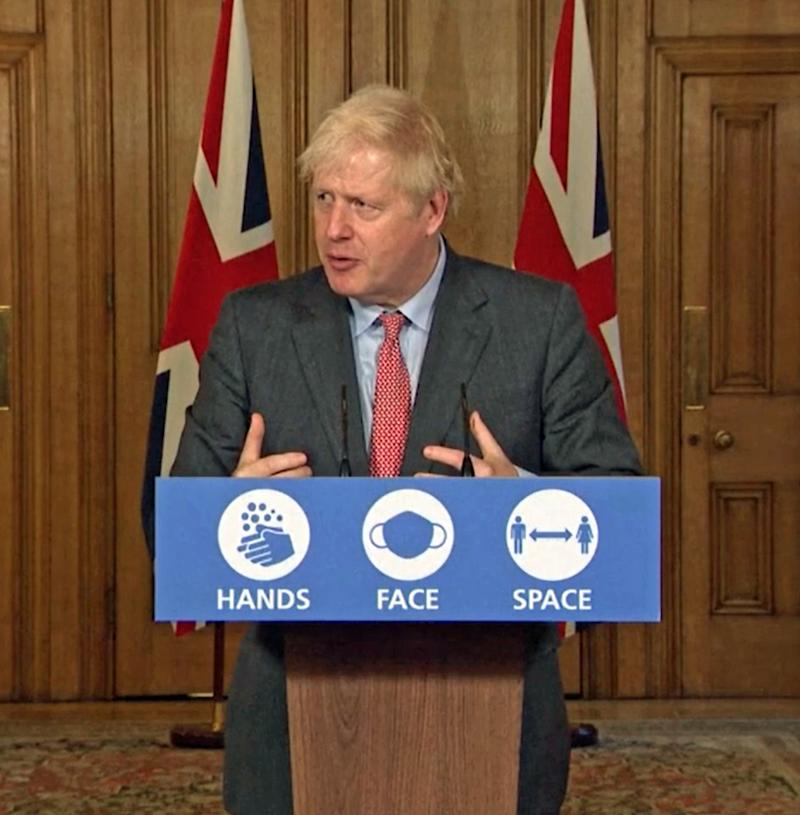 Boris Johnson during a media briefing in Downing Street (PA)
