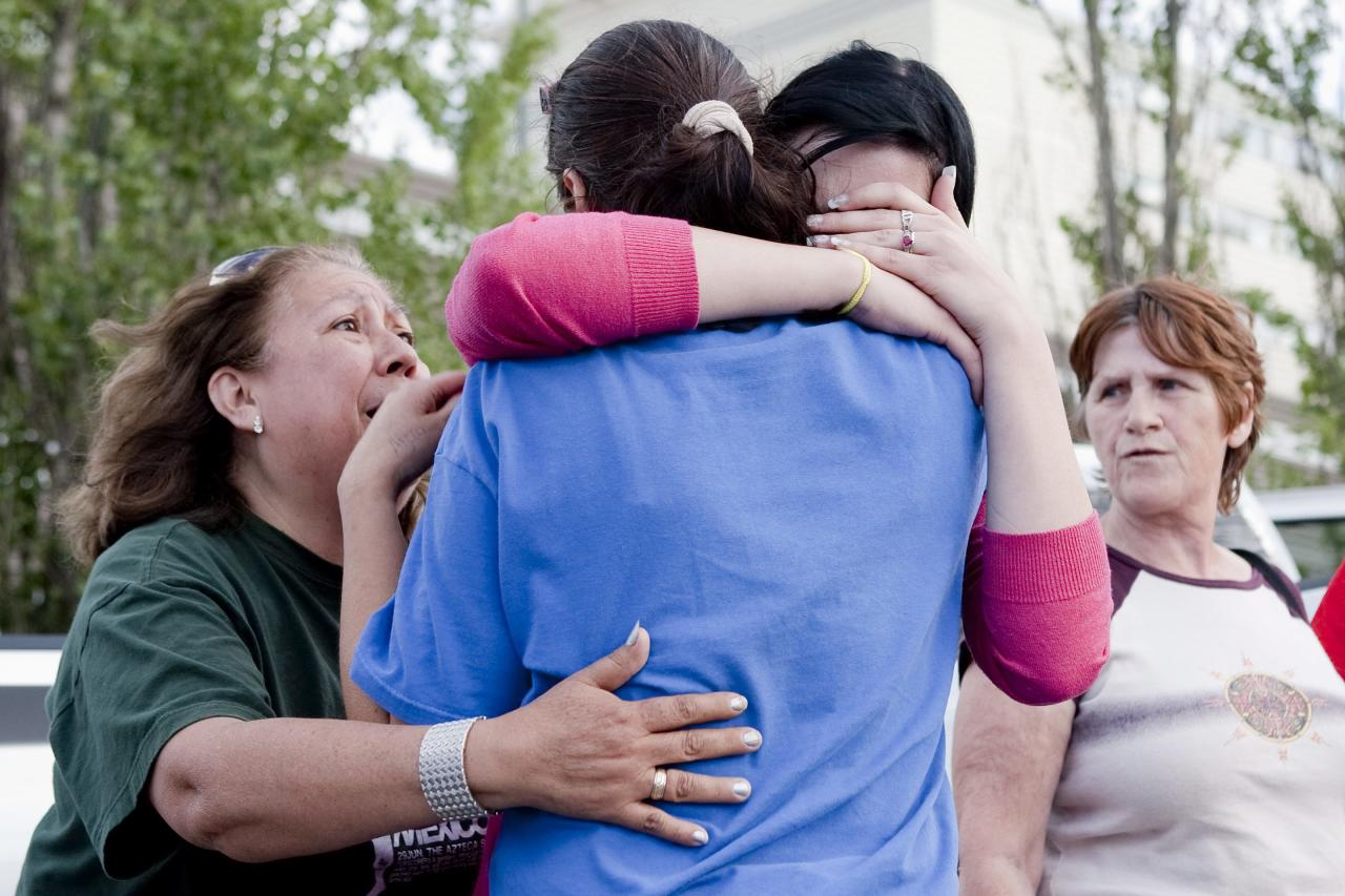 Local residents react to the news that authorities have called off a rescue bid at the site of the collapsed roof of the Algo Centre Mall in Elliot Lake, Ontario, on Monday June 25, 2012. The threat of another collapse at the mall forced rescue crews to abandon their search for possible survivors despite recent signs of life, officials said Monday, days after a falling portion of the structure's roof killed at least one person. The collapse on Saturday afternoon also left at least one other person trapped. (AP Photo/The Canadian Press, Chris Young)