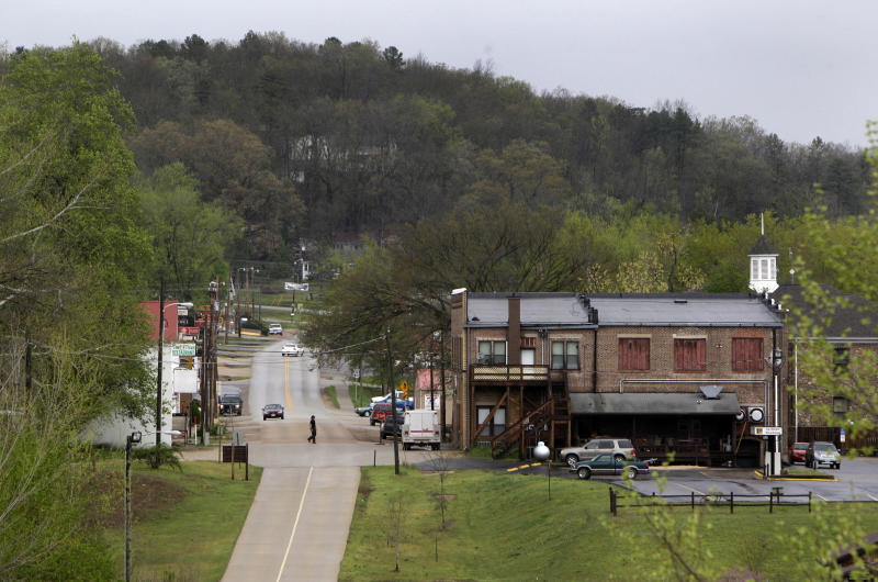 In this April 11, 2011 photo, a road runs through the small southern Missouri town of Van Buren, the county seat of Carter County. Former Carter County Sheriff Tommy Adams was recently arrested by the Missouri Highway Patrol for allegedly distributing methamphetamine and accused of snorting it through a straw in his cabin on the edge of the Missouri Ozarks.  (AP Photo/Jeff Roberson)