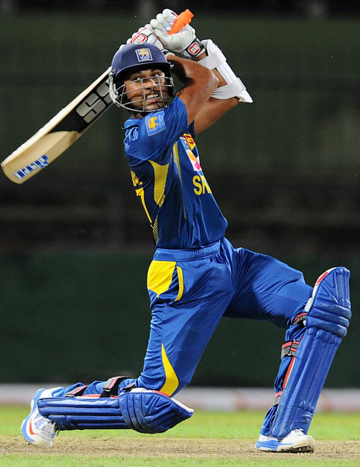 Sri Lankan cricketer Dinesh Chandimal plays a shot during the third One Day International (ODI) cricket match between Sri Lanka and South Africa at the Pallekele International Cricket Stadium in Pallekele on July 26, 2013. AFP PHOTO/ Ishara S.KODIKARA        (Photo credit should read Ishara S.KODIKARA/AFP/Getty Images)