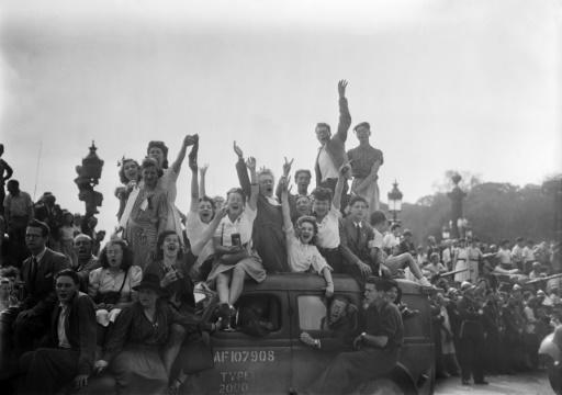 Crowds celebrate after French and Allied soldiers enter Paris in August 1944, confirming its liberation from the Nazis