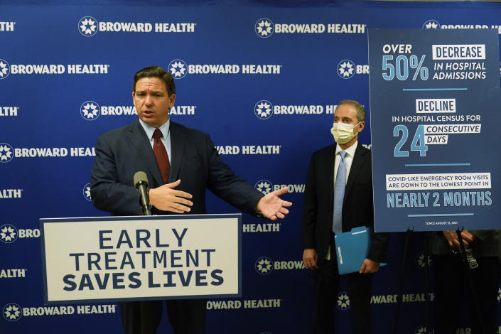 Florida Gov. Ron DeSantis, left, speaks at a news conference alongside Broward Health CEO Shane Strum, Thursday, Sept. 16, 2021, at the Broward Health Medical Center in Fort Lauderdale, Fla. DeSantis was there to promote the use of monoclonal antibody treatments for those infected with COVID-19. (AP Photo/Wilfredo Lee)