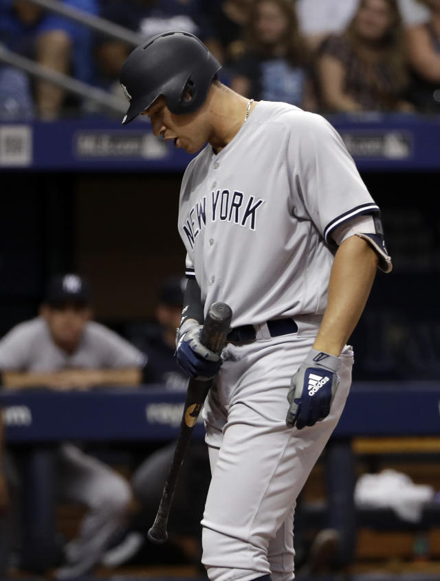 New York Yankees' Aaron Judge has words for home plate umpire Phil Cuzzi after being called out on strikes during the third inning of a baseball game against the Tampa Bay Rays, Friday, June 22, 2018, in St. Petersburg, Fla. (AP Photo/Chris O'Meara)