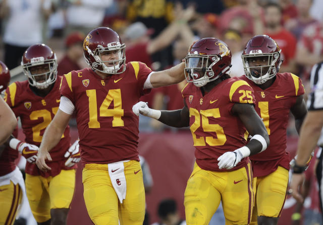"Southern California running back <a class=""link rapid-noclick-resp"" href=""/ncaaf/players/255261/"" data-ylk=""slk:Ronald Jones II"">Ronald Jones II</a>, right, is congratulated by quarterback <a class=""link rapid-noclick-resp"" href=""/ncaaf/players/255254/"" data-ylk=""slk:Sam Darnold"">Sam Darnold</a> after scoring a touchdown during the first half of an NCAA college football game against Stanford, Saturday, Sept. 9, 2017, in Los Angeles. (AP Photo/Jae C. Hong)"
