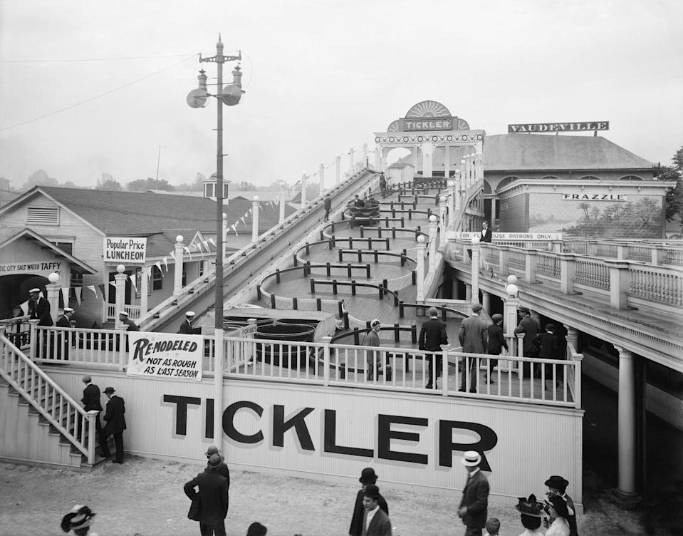 """<p>The Tickler ride sends cards twisting and turning down a curved path. The sign hanging on the entrance fence for this one says it all: """"Remodeled: Not as rough as last season.""""</p>"""