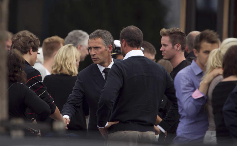 Norway's Prime Minister Jens Stoltenberg, center, shakes hands with a survivor of the shooting at an island youth retreat, as he visited survivors and relatives at a hotel in Sundvolden, Norway, flanking the prime minister at right is the leader of the Labour party's youth group Eskild Pedersen who was on the island during the attacks, Saturday, July 23, 2011.  The 32-year-old man suspected in bomb and shooting attacks that killed at least 91 people in Norway bought six tons of fertilizer before the massacres, the supplier said Saturday as police investigated witness accounts of a second shooter.  Norway's prime minister and royal family visited grieving relatives of the scores of youth gunned down in a horrific killing spree on an idyllic island retreat. A man who said he was carrying a knife was detained by police officers outside the hotel, as the shell-shocked Nordic nation was gripped by reports that Norwegian gunman may not have acted alone.  (AP Photo/Matt Dunham)
