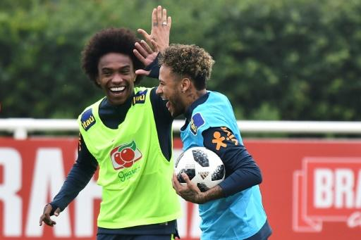 Brazil's striker Neymar (R) high-fives Willian (L)  as they take part in a training session at Tottenham Hotspur's Enfield Training Centre, north-east of London ahead of their friendly with Croatia