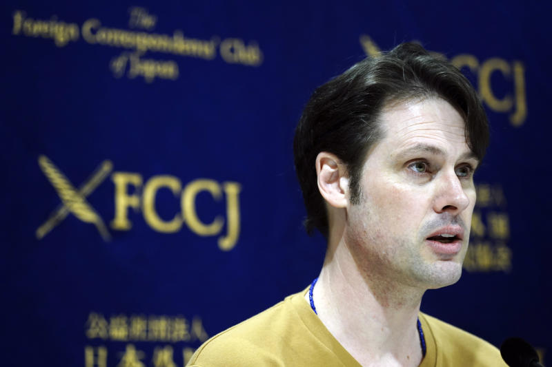 "Tokyo-based Australian journalist Scott McIntyre speaks during a press conference at Foreign Correspondent's Club Japan in Tokyo Thursday, Jan. 16, 2020. McIntyre said he is a victim of ""inhumane"" custody laws that allow only one side of the parents access to children of broken marriages, the day after he was convicted of trespassing at the apartment building of his estranged wife's in-laws for trying to find his children. (AP Photo/Eugene Hoshiko)"