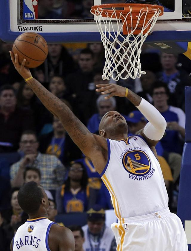 Golden State Warriors' Marreese Speights lays up a shot against the Denver Nuggets during the first half of an NBA basketball game on Wednesday, Jan. 15, 2014, in Oakland, Calif. (AP Photo/Ben Margot)
