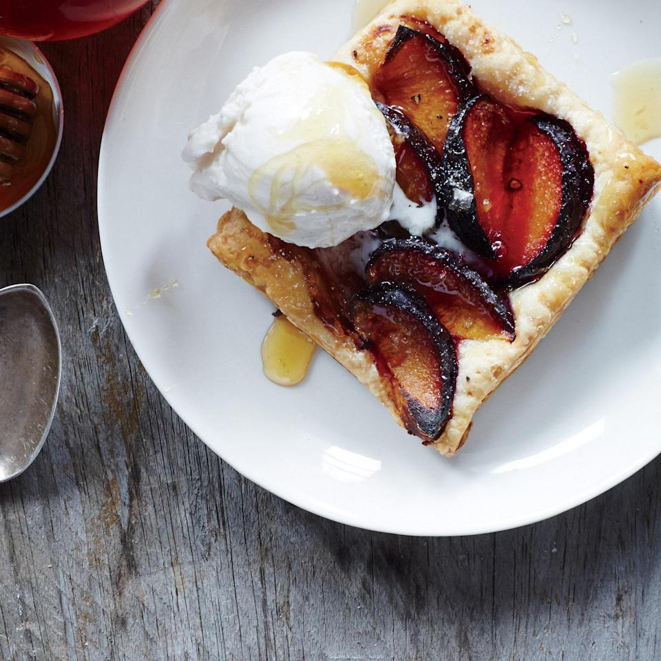 """Since this plum dessert relies on <a href=""""https://www.epicurious.com/recipes-menus/ways-to-use-puff-pastry-recipes-gallery?mbid=synd_yahoo_rss"""" rel=""""nofollow noopener"""" target=""""_blank"""" data-ylk=""""slk:store-bought puff pastry"""" class=""""link rapid-noclick-resp"""">store-bought puff pastry</a>, you can throw it together in minutes. <a href=""""https://www.epicurious.com/recipes/food/views/plum-tarts-with-honey-and-black-pepper-51239610?mbid=synd_yahoo_rss"""" rel=""""nofollow noopener"""" target=""""_blank"""" data-ylk=""""slk:See recipe."""" class=""""link rapid-noclick-resp"""">See recipe.</a>"""