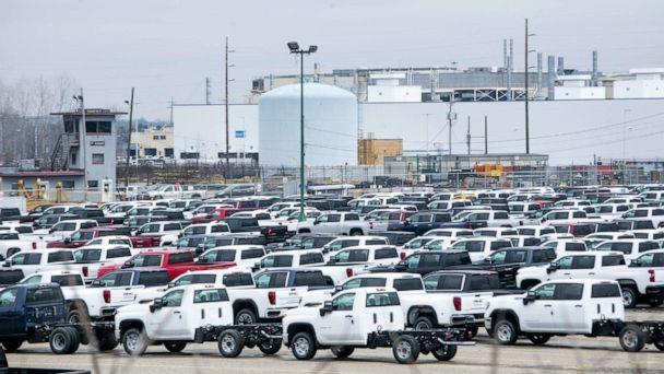 PHOTO: New vehicles sit in a lot in front of the idled General Motors Co. Flint Assembly plant in Flint, Michigan, March 23, 2020. (Anthony Lanzilote/Bloomberg via Getty Images, FILE)