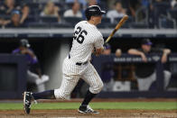 New York Yankees' DJ LeMahieu watches his RBI single during the fourth inning of the team's baseball game against the Colorado Rockies, Friday, July 19, 2019, in New York. (AP Photo/Kathy Willens)
