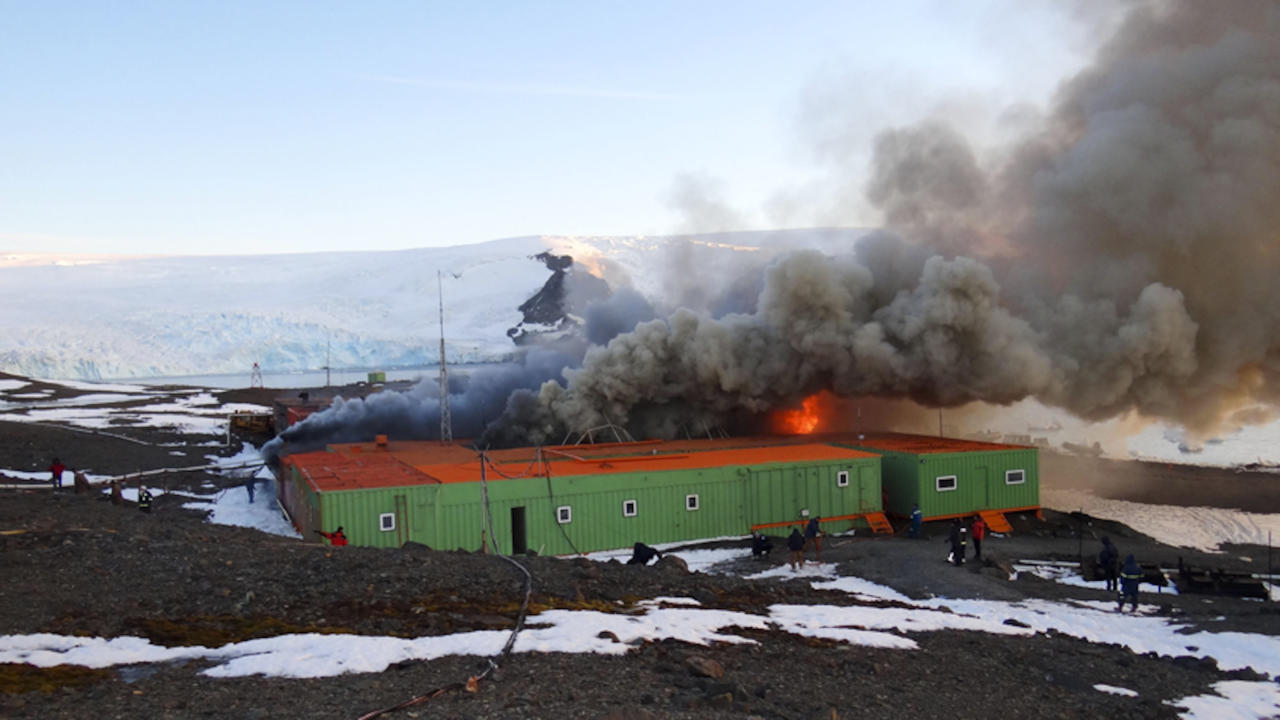 In this photo released by Armada de Chile, fire and smoke rise from Brazil's Comandante Ferraz station in Almirantazgo Bay, in the South Shetland Islands of Antarctica, Saturday Feb. 25, 2012. In an emailed statement, the Brazilian navy said the fire broke out Saturday morning in the machine room that houses the energy generators of the station where one man suffered non-life threatening injuries, and at least two people were reported missing. (AP Photo/Armada de Chile)