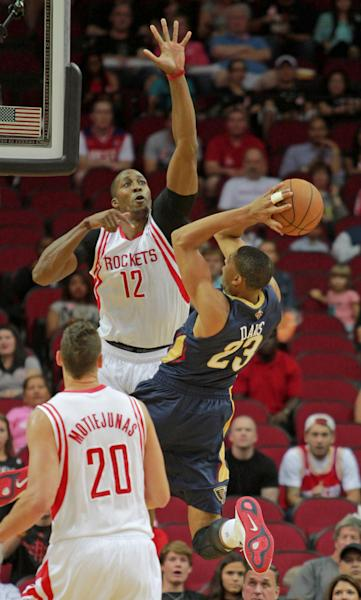 New Orleans Pelicans forward Anthony Davis (23) has his shot blocked by Houston Rockets center Dwight Howard (12) during the first half of a preseason NBA basketball game in Houston, Saturday, Oct. 5, 2013. (AP Photo/Richard Carson)