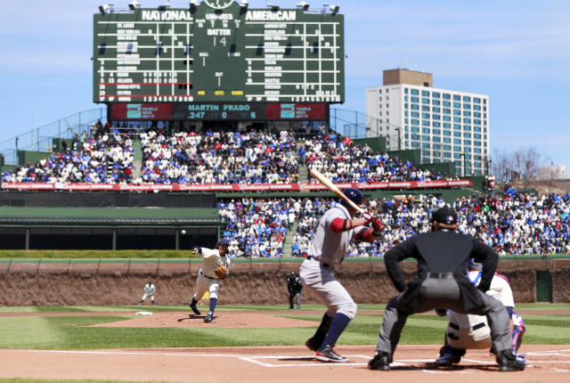 Chicago Cubs starting pitcher Jeff Samardzija delivers a pitch to Arizona Diamondbacks Martin Prado during the first inning at the 100th anniversary of the first baseball game at Wrigley Field, Wednesday, April 23, 2014, in Chicago. (AP Photo/Charles Rex Arbogast)