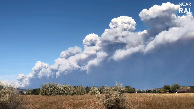 Thick plume of smoke from a wildfire is seen in Boulder County, Colorado
