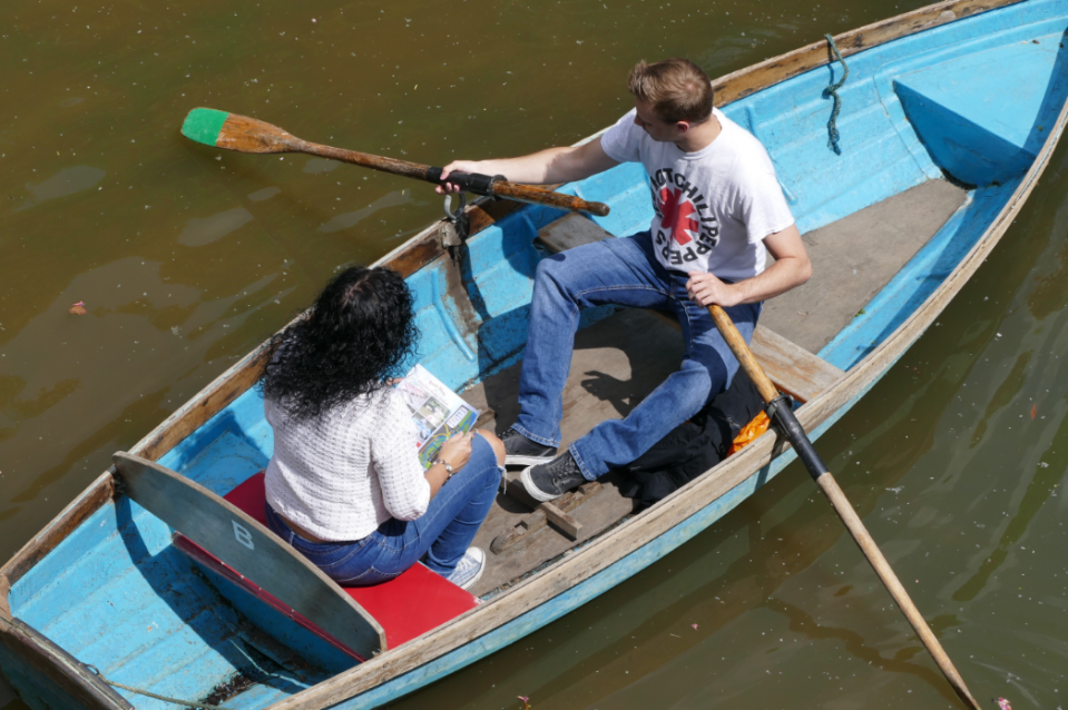 <p>A couple enjoy boating in Christchurch Meadows (Picture: REX) </p>