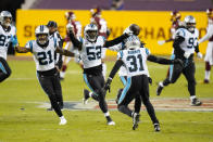 Carolina Panthers middle linebacker Tahir Whitehead (52) celebrating his interception with outside linebacker Jeremy Chinn (21), strong safety Juston Burris (31) and others during the first half of an NFL football game against the Washington Football Team, Sunday, Dec. 27, 2020, in Landover, Md. (AP Photo/Carolyn Kaster)