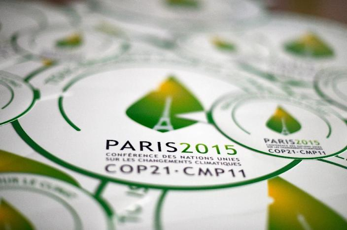 Stickers of the COP21 are seen in Paris, ahead of the Climate Change Conference 2015, on October 30, 2015 (AFP Photo/Dominique Faget)