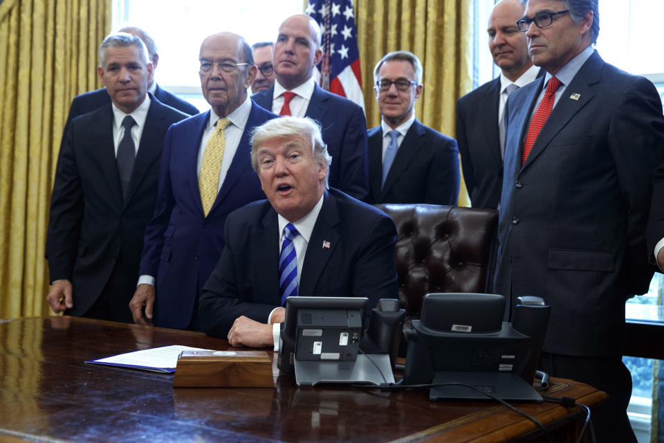 <p> FILE - In this March 24, 2017, file photo, President Donald Trump announces the approval of a permit to build the Keystone XL pipeline, clearing the way for the $8 billion project in the Oval Office of the White House in Washington. From left are, TransCanada CEO Russell K. Girling, Commerce Secretary Wilbur Ross and Energy Secretary Rick Perry. Amid staff turmoil and shake-ups, travel bans blocked by federal courts and the Russia cloud hanging overhead, Trump is plucking away at another piece of his agenda: undoing Obama. (AP Photo/Evan Vucci) </p>