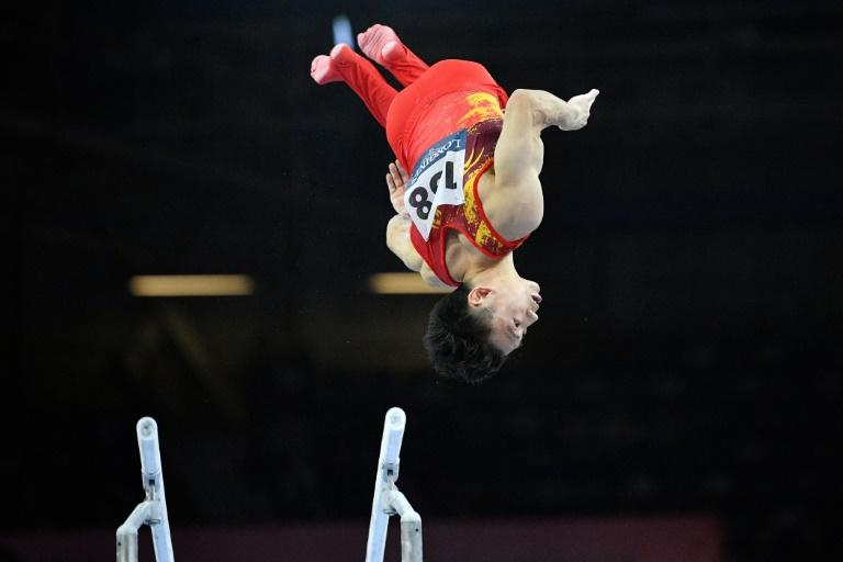Zou Jingyuan scored more than 16 on the parallel bars but it was not enough to secure gold for China