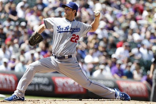 Los Angeles Dodgers starting pitcher Clayton Kershaw (22) works against the Colorado Rockies during the first inning of a baseball game, Wednesday, May 2, 2012, in Denver. (AP Photo/Barry Gutierrez)