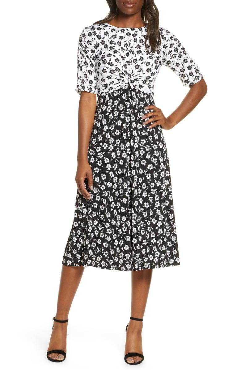 "<p>Wear this <a href=""https://www.popsugar.com/buy/Vince-Camuto-Floral-Reverse-Print-Midi-Dress-550753?p_name=Vince%20Camuto%20Floral%20Reverse%20Print%20Midi%20Dress&retailer=shop.nordstrom.com&pid=550753&price=148&evar1=fab%3Aus&evar9=47237816&evar98=https%3A%2F%2Fwww.popsugar.com%2Fphoto-gallery%2F47237816%2Fimage%2F47238401%2FVince-Camuto-Floral-Reverse-Print-Midi-Dress&list1=shopping%2Cdresses%2Cspring%20fashion&prop13=api&pdata=1"" class=""link rapid-noclick-resp"" rel=""nofollow noopener"" target=""_blank"" data-ylk=""slk:Vince Camuto Floral Reverse Print Midi Dress"">Vince Camuto Floral Reverse Print Midi Dress </a> ($148) with a leather jacket.</p>"