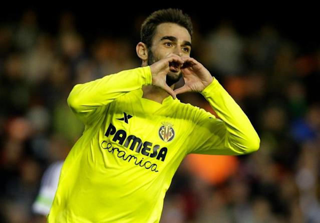 Villarreal's forward Adrian Lopez celebrates his second goal during the Spanish league football match Valencia CF vs Villarreal CF at the Mestalla stadium in Valencia on May 1, 2016