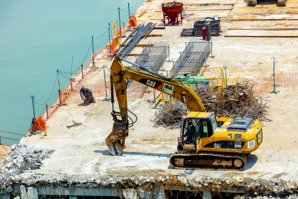 An excavator at a construction site in Singapore. (PHOTO: Getty Images)