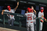 St. Louis Cardinals' Dexter Fowler (25) celebrates in the dugout after his home run in the third inning of Game 1 of a baseball doubleheader against the Chicago Cubs, Monday, Aug. 17, 2020, in Chicago. (AP Photo/Matt Marton)