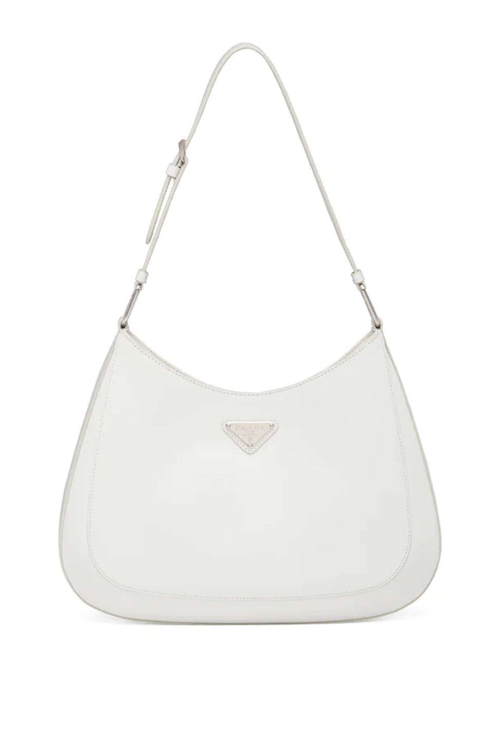 """<p><a class=""""link rapid-noclick-resp"""" href=""""https://www.prada.com/gb/en/products.prada_cleo_brushed_leather_shoulder_bag.1BC156_ZO6_F0009_V_OOO.html"""" rel=""""nofollow noopener"""" target=""""_blank"""" data-ylk=""""slk:SHOP NOW"""">SHOP NOW</a></p><p>The Cleo bag takes influence from archival Prada. With its sleek and streamline appearance, it is not hard to see why it has been such a huge hit with fashion editors and influencers worldwide.</p><p>Leather bag, £1,850, <a href=""""https://www.prada.com/gb/en/products.prada_cleo_brushed_leather_shoulder_bag.1BC156_ZO6_F0009_V_OOO.html"""" rel=""""nofollow noopener"""" target=""""_blank"""" data-ylk=""""slk:Prada"""" class=""""link rapid-noclick-resp"""">Prada</a></p>"""
