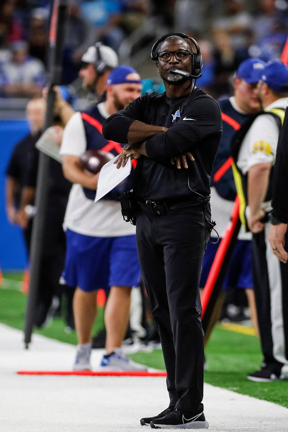 Lions defensive coordinator Aaron Glenn watches a play against the Ravens during the first half of the Lions' 19-17 loss at Ford Field on Sunday, Sept. 26, 2021.
