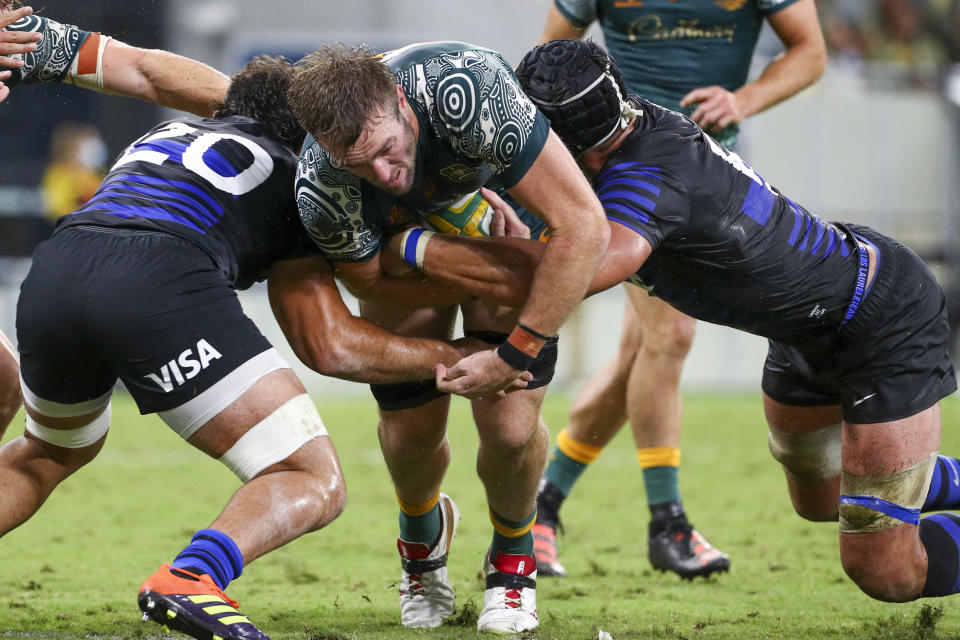 Australia's Izack Rodda is tackled by defenders during the Rugby Championship test match between the Pumas and the Wallabies in Townsville, Australia, Saturday, Sept. 25, 2021. (AP Photo/Tertius Pickard)