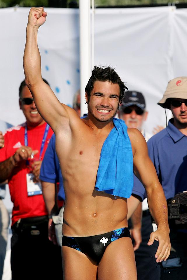 MONTREAL - JULY 19: Alexandre Despatie of Canada celebrates winning the gold medal in the Men's 3 meter Springboard final during the XI FINA World Championships on July 19, 2005 at the Parc Jean-Drapeau in Montreal, Quebec, Canada. (Photo by Alexander Hassenstein/Bongarts/Getty Images)