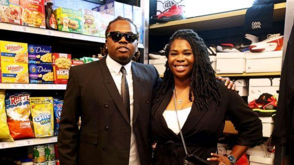 PHOTO: Hip-hop artist Gunnar poses with Goodr founder Jasmine Crowe at the grand opening of Gunna's Drip Closet and Goodr Grocery Store at McNair Middle School on Sept. 16, 2021. (Maurice Holloway/Goodr)