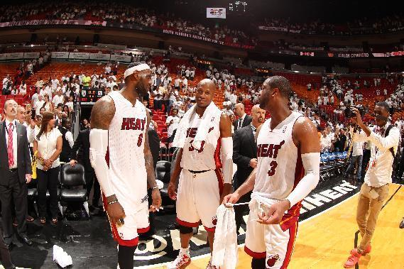 MIAMI, FL - May 26: Dwyane Wade #3, LeBron James #6, and Ray Allen #34 of the Miami Heat celebrate after Game Four of the Eastern Conference Finals against the Indiana Pacers during the 2014 NBA Playoffs at the American Airlines Arena in Miami, Florida on May 26, 2014. (Photo by Issac Baldizon/NBAE via Getty Images)
