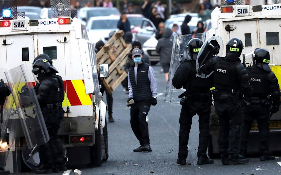 Police tried to repel nationalists from the Springfield Road area - AP