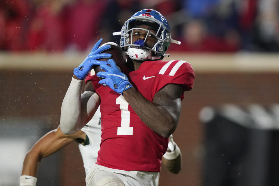 Mississippi wide receiver Jonathan Mingo (1) pulls in a pass for a 50-yard touchdown against Tulane during the first half of an NCAA college football game Saturday, Sept. 18, 2021, in Oxford, Miss. (AP Photo/Rogelio V. Solis)
