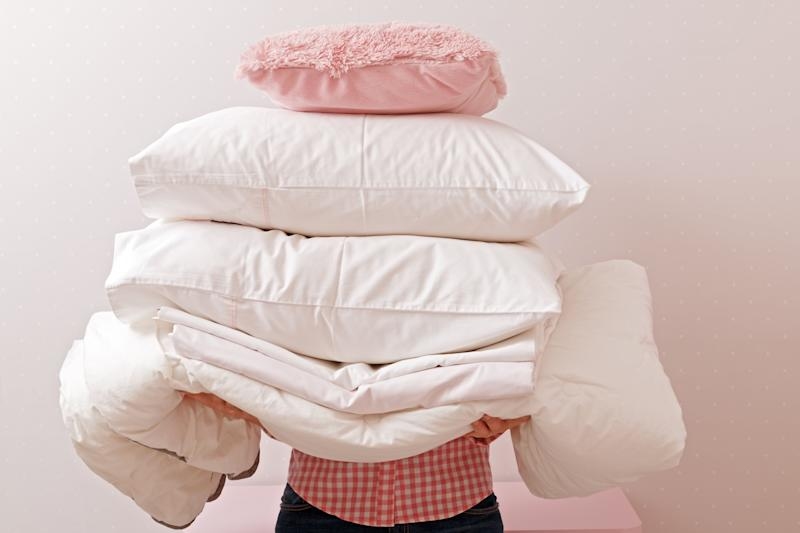 The good news is that there are moves you can make to extend the life of your pillows when it comes to hygiene, the first being washing your pillow case every week. (Photo: Olga Nikiforova via Getty Images)