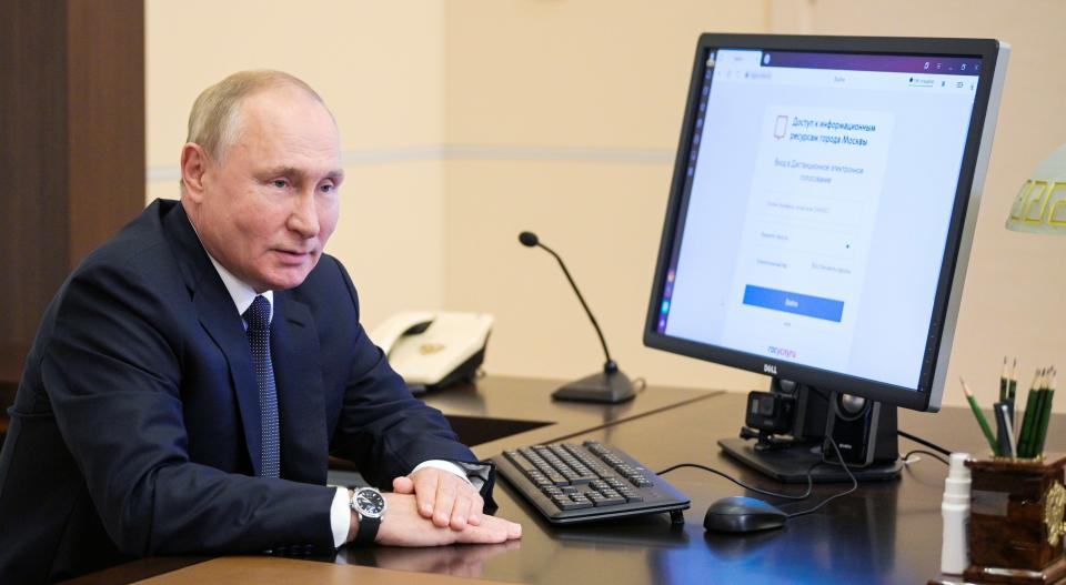 Russian President Vladimir Putin attends a remote electronic voting during Parliamentary elections at the Novo-Ogaryovo residence outside Moscow, Russia, Friday, Sept. 17, 2021. Russia has begun three days of voting for a new parliament that is unlikely to change the country's political complexion. There's no expectation that United Russia, the party devoted to President Vladimir Putin, will lose its dominance in the State Duma. (Alexei Druzhinin, Sputnik, Kremlin Pool Photo via AP)