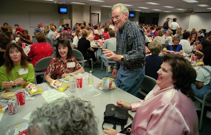 Clad in jeans and a plaid shirt, Southwest Airlines chairman Herb Kelleher, attends a luncheon meeting with his employees at Dallas headquarters May 8, 1996 where every day is dress-down day. What began as a tiny commuter serving three Texas cities with four planes and 190 employees has grown to 224 planes and 21,000 employees. Now serving 23 states and serving 48 cities, the airline celebrates its 25th anniversary in June. (AP Photo/Tim Sharp)