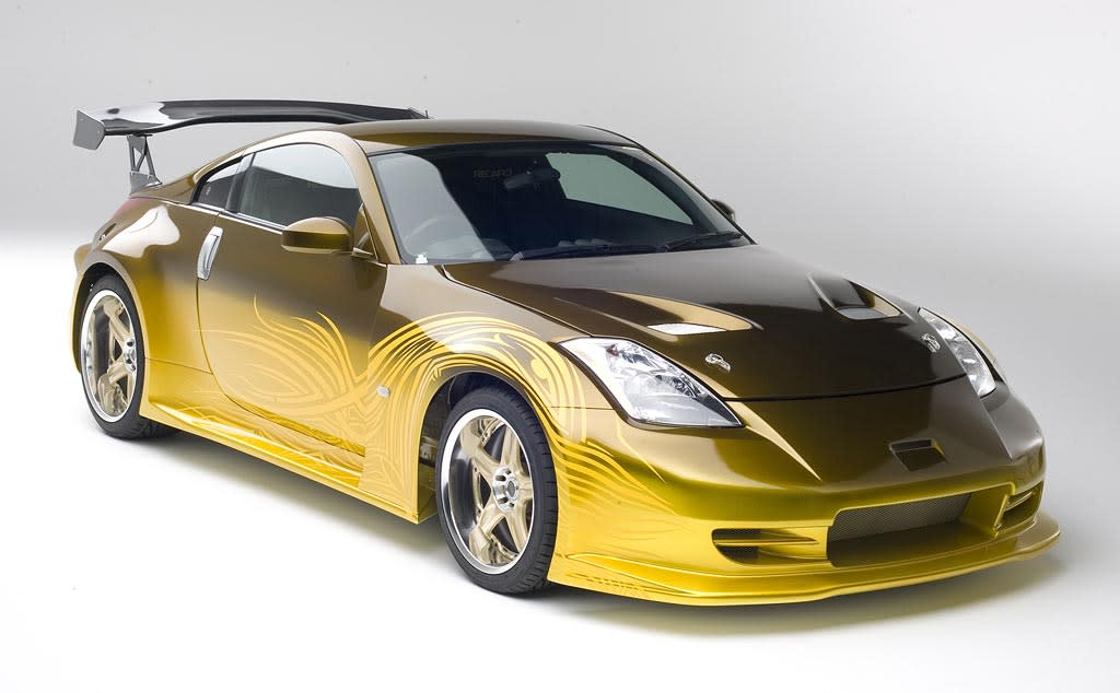 "2002 NISSAN 350Z FAIRLADY  As Seen In: <a href=""http://movies.yahoo.com/movie/1808715999/info"">The Fast and the Furious: Tokyo Drift</a>  Key Technical Specs: 287 horsepower 3.5L V6; runs on regular, not (Vin) diesel.   A lot of cars are fast. Some are furious. But few cars combine speed with anger management issues like 350Z Fairlady. With its custom paint job and fine tuned suspension system you'll be drifting like a Tokyo crime lord.   Available Options: Discontinued <a href=""http://movies.yahoo.com/movie/contributor/1800019262"">Paul Walker</a> add-on is available <a href=""http://movies.yahoo.com/movie/1809989992/info"">again</a>."