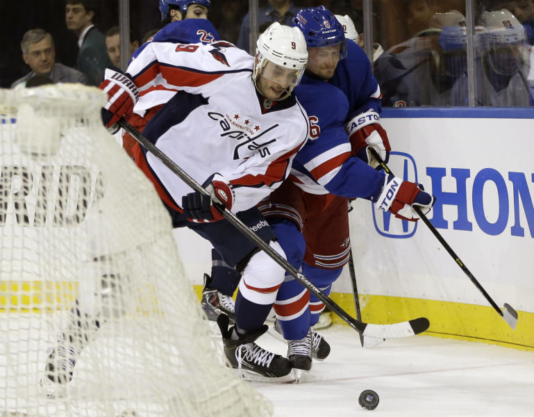 Washington Capitals center Mike Ribeiro (9) fends off New York Rangers defenseman Anton Stralman (6), of Sweden, in the first period of Game 3 of their first-round NHL hockey Stanley Cup playoff series in New York, Monday, May 6, 2013. (AP Photo/Kathy Willens)