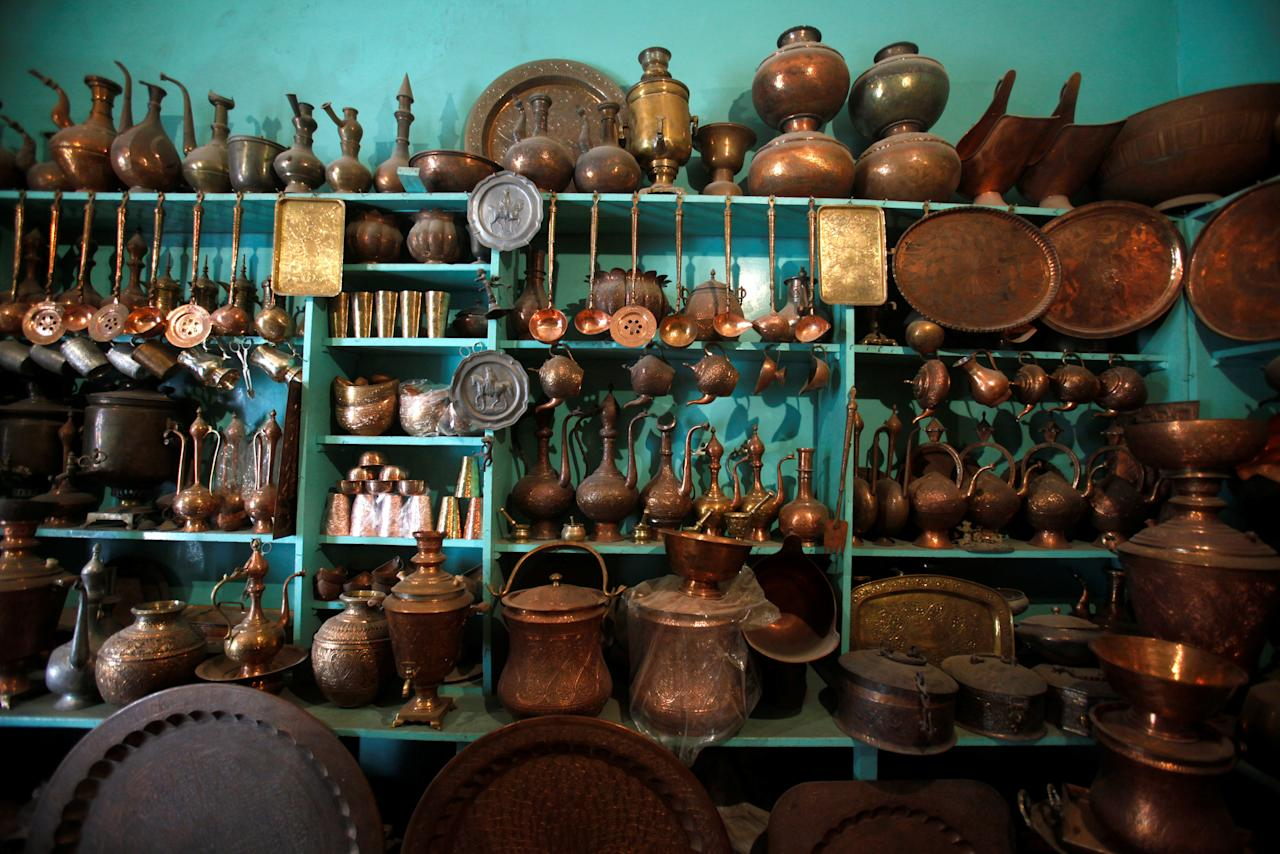 Copper utensils are seen on display at a shop in Peshawar, Pakistan October 23, 2017.  REUTERS/Fayaz Aziz